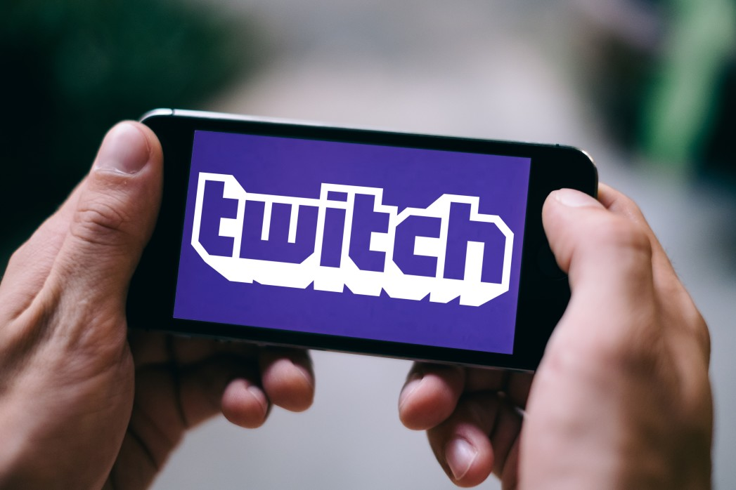 person watching a twitch stream on their phone