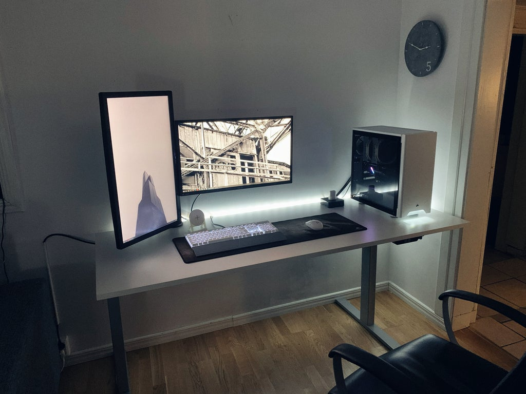 white minimalist gaming setup with vertical monitor